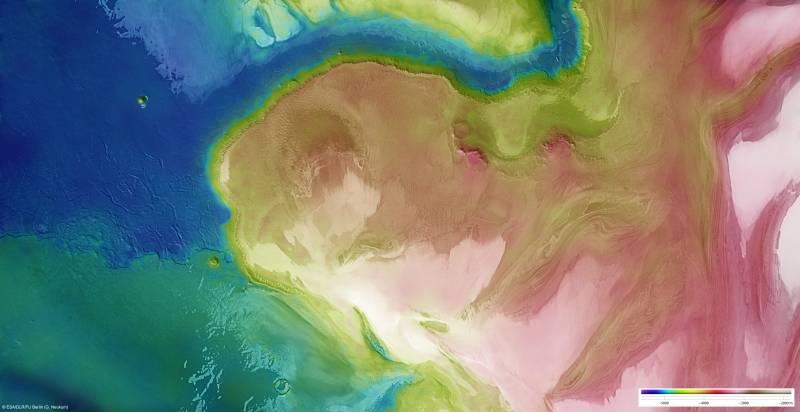 Obtienen imágenes del polo norte de Marte cubierto de hielo