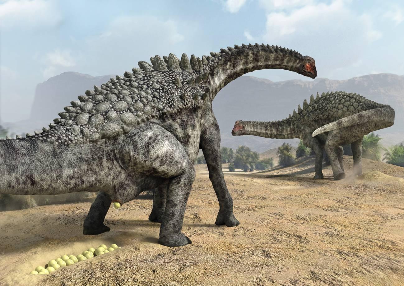 Recreación artística de la puesta de huevos de un ampelosaurus.  / J.A. Peñas | SINC
