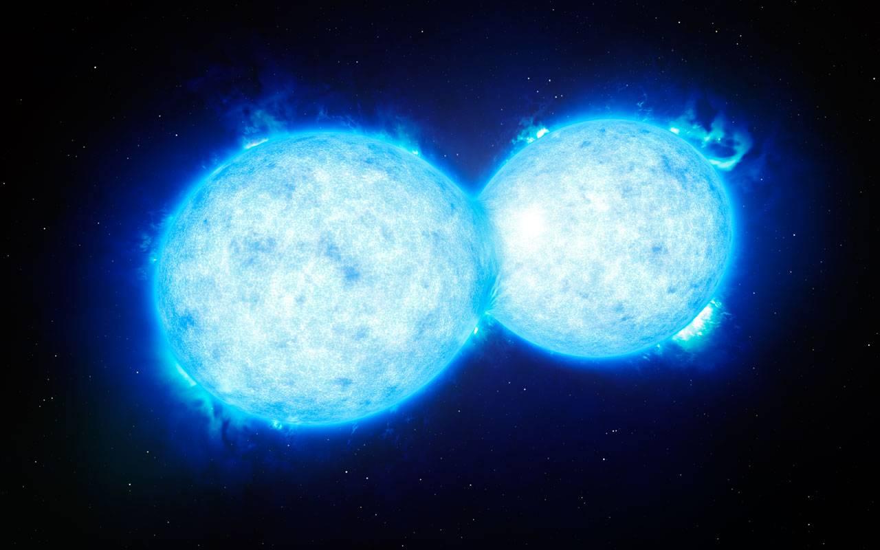 Ilustración de las estrellas del sistema binario de contacto más masivo y caliente. / ESO/L. Calçada